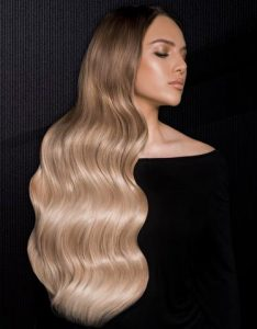 After image of long full thick blonde wavy hair extensions-hair salon solana beach -Salon LG-+1 858 344 7865.